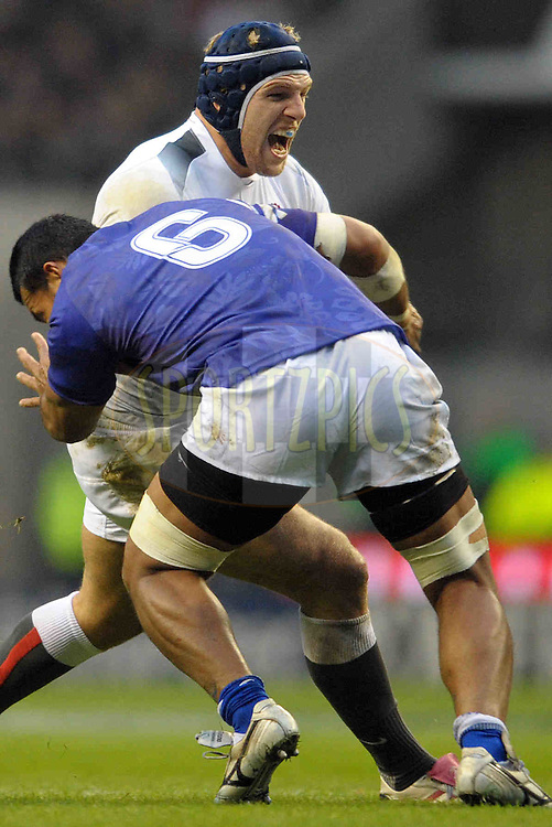© SPORTZPICS /  SECONDS LEFT IMAGES 2010 - Rugby Union - Investec Challenge - England v Samoa - 20/11/10 - England's James Haskell shout defiance as he is tackled by Samoa's Ofisa Treviranus.- at Twickenham Stadium UK - All rights reserved