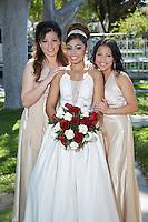 Portrait of bride with bridesmaids in garden