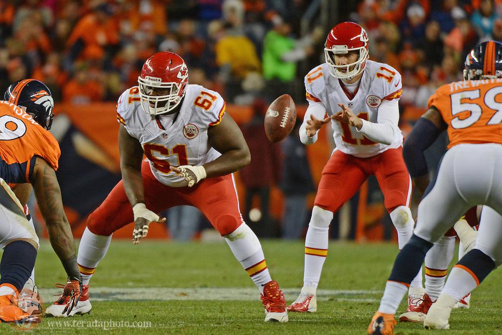 November 17, 2013; Denver, CO, USA; Kansas City Chiefs center Rodney Hudson (61) snaps the football to quarterback Alex Smith (11) during the second quarter against the Denver Broncos at Sports Authority Field at Mile High. The Broncos defeated the Chiefs 27-17.