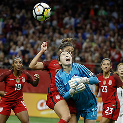 Oct 19, 2017; New Orleans, LA, USA; USA midfielder Carli Lloyd (10) collides with Korea Republic goal keeper Kang Gaae (1) as she shoots during the second half of an International Friendly Women's Soccer match at the Mercedes-Benz Superdome. Mandatory Credit: Derick E. Hingle-USA TODAY Sports