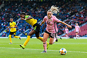 Erin Cuthbert (#22) of Scotland battles to win possession of the ball from Den-Den Blackwood (#14) of Jamaica during the International Friendly match between Scotland Women and Jamaica Women at Hampden Park, Glasgow, United Kingdom on 28 May 2019.