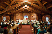 PRICE CHAMBERS / NEWS&amp;GUIDE<br /> Bishop Paul D. Etienne of the Diocese of Cheyenne celebrates Mass on August 15, as the congregation recognizes the 75th anniversary of the Chapel of the Sacred Heart in Grand Teton National Park. The church near Jackson Lake was originally dedicated in 1937.