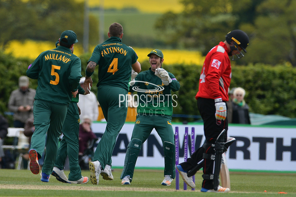 James Pattinson and Chris Read celebrate the wicket of Tom Wells during the Royal London 1 Day Cup match between Nottinghamshire County Cricket Club and Leicestershire County Cricket Club at Wellbeck Colliery Cricket Club, Nettleworth, United Kingdom on 7 May 2017. Photo by Simon Trafford.