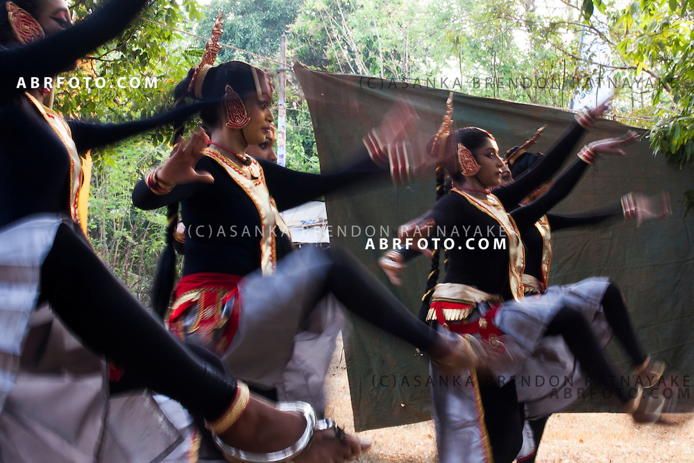Traditional Sri Lankan dancers dance at the Udawalawe National Park lies on the boundary of Sabaragamuwa and Uva Provinces, in Sri Lanka. The national park was created to provide a sanctuary for wild animals