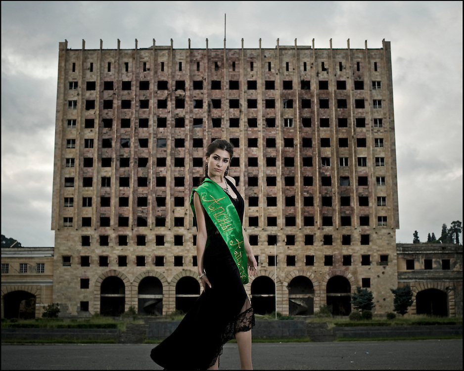Miss Abkhazia in front of the ancient Soviet Parliament which was burned by the Georgians during the war of 1992-1993, and become the symbol of Sukhoumi.