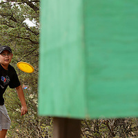 070513  Adron Gardner/Independent<br /> <br /> Joshua Salazar aims for a frisbee golf goal at the Broken Arrow Bible Ranch near Vanderwagen Friday.