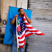 An immigrant kisses the American flag as he watches immigrant rights supporters march in Los Angeles as part of May Day celebration. Please contact Todd Bigelow directly with your licensing requests. PLEASE CONTACT TODD BIGELOW DIRECTLY WITH YOUR LICENSING REQUEST. THANK YOU!