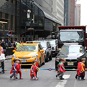 Stopping the traffic in New York City. Pre schoolers cross the road with their supervisors on 42nd Street outside Grand Central Terminal in Manhattan, New York, USA. 30th September 2014. Photo Tim Clayton