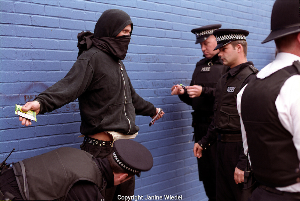 Young demonstrator being searched by police under section 44 at an arms trade demonstration in London.