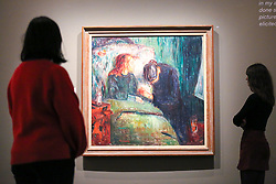 "© Licensed to London News Pictures. 08/04/2019. London, UK. Staff members view Edvard Munch's ""The Sick Child, 1907"". It took Munch one year to complete the painting, which created a sensation when it was displayed at the Berlin Artists' Association in November 1892. The scene recalls the death at the age of 15 of Munch's beloved older sister, Sophie, from tuberculosis. The mourning woman is Munch's aunt, Karen Bjolstad, who looked after Munch and his siblings after the death of their mother in 1868.<br /> <br /> The work of Norwegian artist Edvard Munch (1863-1944) - ""Edvard Munch: love and angst"" at the British Museum opens from 11 April until 21 July 2019. The exhibition focus on Munch's remarkable and experimental prints – an art form which made his name and at which he excelled throughout his life – and will examine his unparalleled ability to depict raw human emotion. It will be the largest exhibition of Munch's prints in the UK for 45 years. Photo credit: Dinendra Haria/LNP"