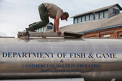 A worker checks on the one of the truckloads of Fingerling Chinook salmon pumped into floating holding pens along the Mare Island Strait in Vallejo, California. The U.S. Fish and Wildlife Service expects to haul about 30 million of the young salmon from the Coleman National Hatchery near Red Bluff in climate-controlled tanker trucks during the operation.  Due to the worst drought to hit California in 40 years, the program protects the 3-inch long salmon from low river flows, warm water and  predators on their journey to the Pacific Ocean.