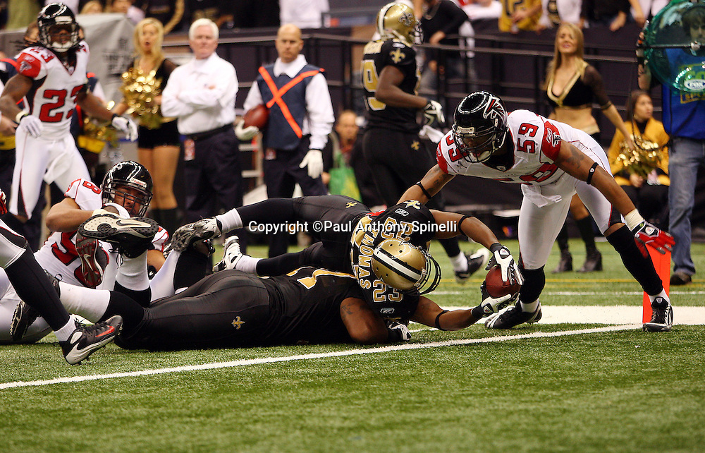 NEW ORLEANS - DECEMBER 07: Running back Pierre Thomas #23 of the New Orleans Saints stretches backwards over the pile as he scores the winning touchdown in the fourth quarter of the game against the Atlanta Falcons at the Louisiana Superdome on December 7, 2008 in New Orleans, Louisiana. The Saints defeated the Falcons 29-25. ©Paul Anthony Spinelli *** Local Caption *** Pierre Thomas