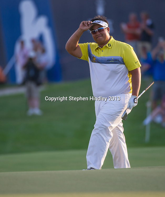 Kiradech Aphibarnrat of Thailand after chipping his final shot from the edge of the 18th straight into the hole, during the second round of the DP World Tour Championship held at the Jumeirah Golf Estates in Dubai, United Arab Emirates, on Friday, November 15, 2013.  Photo by: Stephen Hindley/SPORTDXB