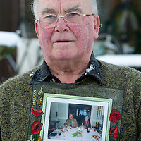 Alisdair Macfarlane pictured with a photo of his wife Morna and himself at their home in Bridge of Cally....14.01.13 <br /> Morna passed away recently and was held in the Tayside Police mortuary for an extended period of time much to the disgust of her husband Alistair, who has now complained to Tayside Police.<br /> Picture by Graeme Hart.<br /> Copyright Perthshire Picture Agency<br /> Tel: 01738 623350  Mobile: 07990 594431
