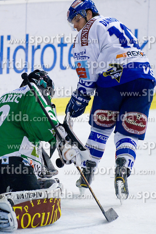 Matija Pintaric (HDD Tilia Olimpija, #69) vs Derek Damon (EC Rekord-Fenster VSV, #10) during ice-hockey match between HDD Tilia Olimpija and EC Rekord-Fenster VSV in 46th Round of EBEL league, on Februar 6, 2011 at Hala Tivoli, Ljubljana, Slovenia. (Photo By Matic Klansek Velej / Sportida.com)