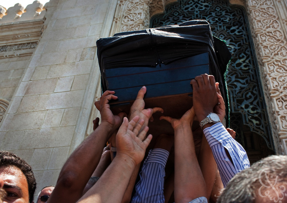 "Family members and friends carry the coffin of Marwa Sherbini, 31, at her funeral in the Egyptian port city of Alexandria July 6, 2009. Sherbini was stabbed to death inside a German courtroom by a 28 year old attacker, Axel W., who had been previously convicted of insulting her religion. Newspapers in Egypt have expressed outrage over the attack and have dubbed her the ""martyr of the hijab"" and ""headscarf martyr."""