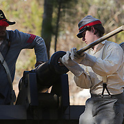 Jonathan Nunnery demonstrates how to load a cannon Sunday February 8, 2015 during the 10th Annual Civil War Living History Weekend at Cameron Art  Museum. The Weekend commemorated the Battle of Forks Road. (Jason A. Frizzelle)