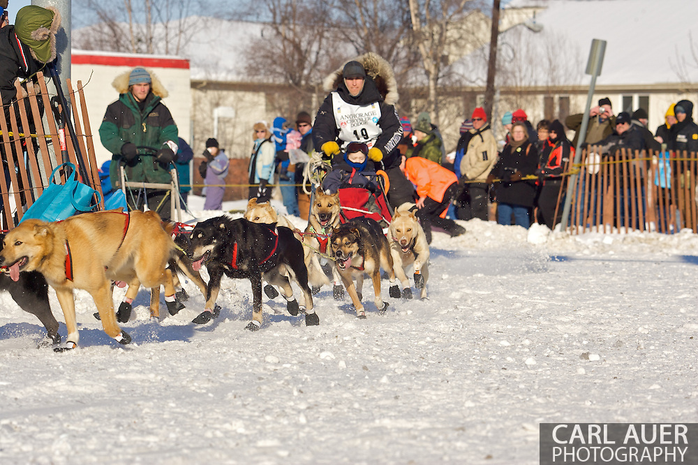March 7th, 2009:  Anchorage, Alaska: Making the hard turn from 4th to Cordova, the dogs of Willow, Alaska's Matt Hayashida take the corner at full speed during the start of the 2009 Iditarod.