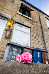 © Licensed to London News Pictures. 08/07/2015. Barnsley, UK. Picture shows flowers outside a house on Cherry Tree Street in Barnsley where Two people have died in a house fire. A man & woman were pronounced dead after the blaze at about 18:50 on Tuesday. A South Yorkshire Fire & Rescue spokesman said despite the considerable efforts of firefighters & ambulance crews at the scene, both sale passed away. Photo credit : Andrew McCaren/LNP