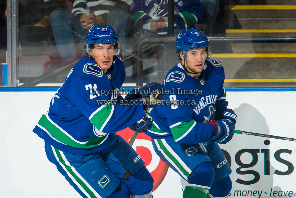 KELOWNA, BC - SEPTEMBER 29: Brendan Leipsic #9 and Loui Eriksson #21 of the Vancouver Canucks skate along the boards against the Arizona Coyotes  at Prospera Place on September 29, 2018 in Kelowna, Canada. (Photo by Marissa Baecker/NHLI via Getty Images)  *** Local Caption *** Brendan Leipsic;Loui Eriksson