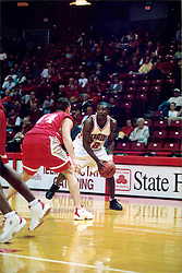 November 01, 2001:  Illinois State Redbirds basketball player Tarise Bryson guarded by Jason Reiter...This image was scanned from a print.  Image quality may vary.  Dust and other unwanted artifacts may exist.