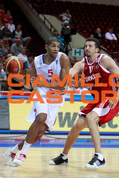 DESCRIZIONE : Katowice Poland Polonia Eurobasket Men 2009 Semifinal 5-8 place Francia France Turchia Turkey <br /> GIOCATORE : Nicolas Batum<br /> SQUADRA : Francia France<br /> EVENTO : Eurobasket Men 2009<br /> GARA : Francia France Turchia Turkey <br /> DATA : 19/09/2009 <br /> CATEGORIA :<br /> SPORT : Pallacanestro <br /> AUTORE : Agenzia Ciamillo-Castoria/H.Bellenger<br /> Galleria : Eurobasket Men 2009 <br /> Fotonotizia : Katowice  Poland Polonia Eurobasket Men 2009 Semifinal 5-8 place Francia France Turchia Turkey <br /> Predefinita :