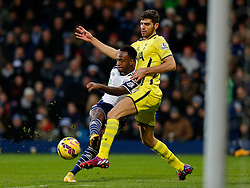 Saido Berahino of West Brom shoots past Federico Fazio of Tottenham Hotspur but his effort hits the post - Photo mandatory by-line: Rogan Thomson/JMP - 07966 386802 - 31/01/2015 - SPORT - FOOTBALL - West Bromwich, England - The Hawthorns - West Bromwich Albion v Tottenham Hotspur - Barclays Premier League.