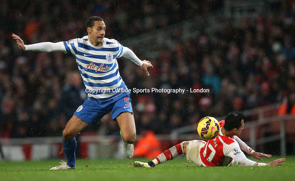 26 December 2014 Premier League Football - Arsenal v Queens Park Rangers ;  Rio Ferdinad of Rangers wins the ball from Alexis Sanchez.<br /> Photo: Mark Leech.
