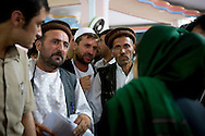 Even after the event is finished, people try to talk to MP Ms. Fawzia Koofi to share their thoughts, problems and ask her for help as one of their Parliament representatives. Faizabad, Afghanistan, 2012