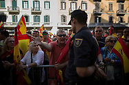 """Spain, Barcelona: Protesters congratulate Spanish policeman after a demonstration called by """"Societat Civil Catalana"""" (Catalan Civil Society) to support the unity of Spain on October 8, 2017 in Barcelona.Catalans calling themselves a """"silent majority"""" opposed to leaving Spain broke their silence after a week of mounting anxiety over the country's worst political crisis in decades."""