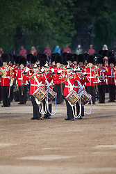 © Licensed to London News Pictures. 13/06/2012. LONDON, UK. Members of the Household Division perform during the annual Beating Retreat parade at Horse Guards Parade in London. On two successive evenings each year in June a pageant of military music, precision drill and colour takes place on Horse Guards Parade in the heart of London when the Massed Bands of the Household Division carry out the Ceremony of Beating Retreat. 300 musicians, drummers and pipers perform this age-old ceremony. The Retreat has origins in the early days of chivalry when beating or sounding retreat pulled a halt to the days fighting. Photo credit: Matt Cetti-Roberts/LNP