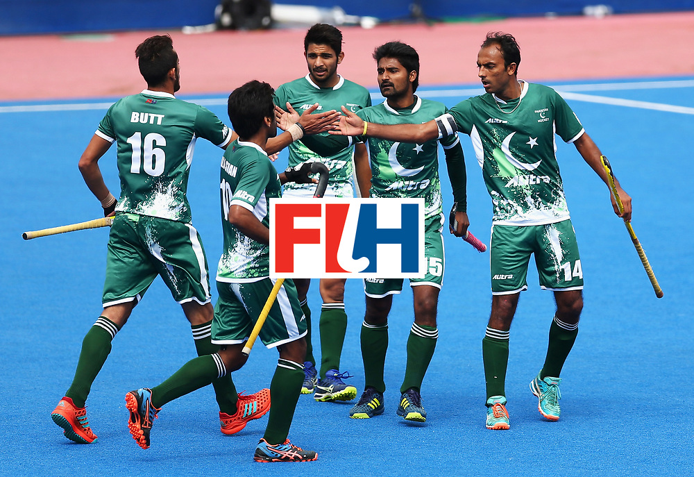 LONDON, ENGLAND - JUNE 25:  Muhammad Umar Bhutta of Pakistan celebrates scoring his sides first goal with his Pakistan team mates during the 7th/8th place match between Pakistan and China on day nine of the Hero Hockey World League Semi-Final at Lee Valley Hockey and Tennis Centre on June 25, 2017 in London, England.  (Photo by Steve Bardens/Getty Images)