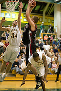 1/6/2006: Junior forward Carl Arts (34) of the UAA Seawolves tries to block a shot by Grant Assink of the Central Washington Wildcats who slipped past UAA's Eric Draper (25).  The University of Alaska-Anchorage would go on to beat the visiting Central Washington Wildcats, 80-60 at the Wells Fargo Sports Complex on the campus of UAA.<br />