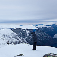 Man standing on Bakkanosi. Breiskrednosi and Skoganosi in the middle.