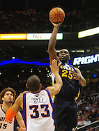 Feb. 15, 2011; Phoenix, AZ, USA; Utah Jazz center Al Jefferson (25) puts up a shot against the Phoenix Suns forward Grant Hill (33) at the US Airways Center.  The Suns defeated the Jazz 102-101. Mandatory Credit: Jennifer Stewart-US PRESSWIRE