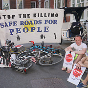 London,England,UK. 26th May 2017. Cyclists  hold a protests in front of the Tory Party HQ against Pollution/Bike Safety vigil and Die-In outside the Tory Party HQ. by See Li