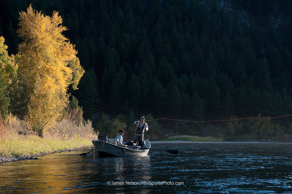 An angler casts a fly during a late-afternoon sulfer dun hatch on an autumn day on the South Fork of the Snake River, Idaho.