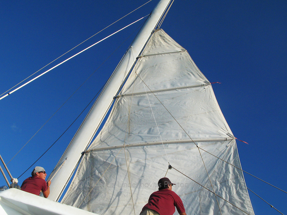 Raising the sail on a sailboat