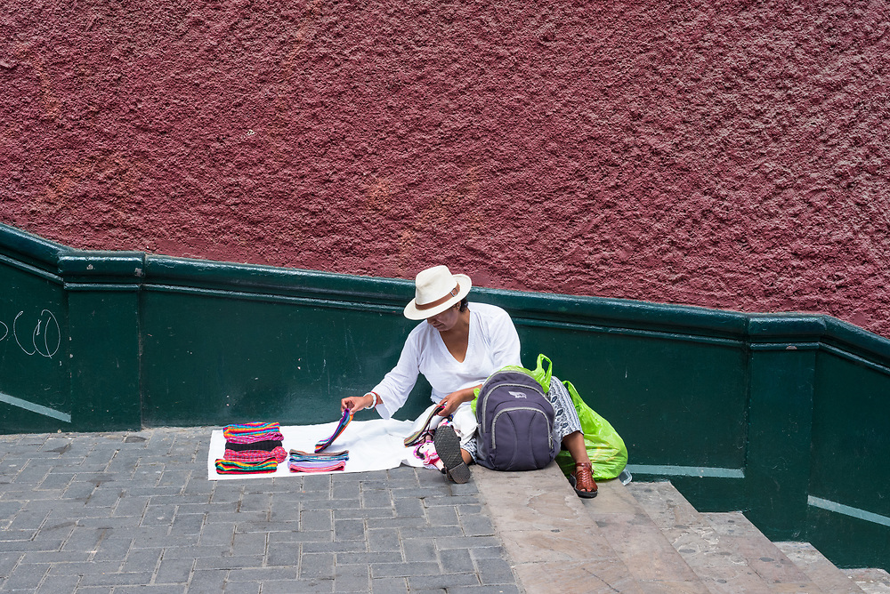Lima, Peru -- April 13, 2018. A street vendor displays scarves for sale on stairs near the Bridge if Sighs. Editorial use only.