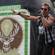 Lead singer Chris Jericho of the band Fozzy sings onstage at the Rockstar Energy Drink Festival at the 1-800-Ask-Gary amphitheater in Tampa, Florida on Thursday, September 13, 2012. (AP Photo/Alex Menendez)