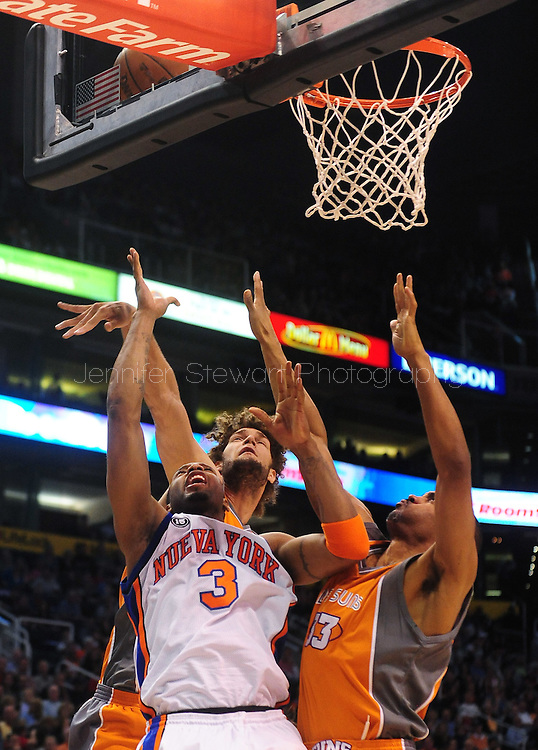 Mar. 26 2010; Phoenix, AZ, USA; New York Knicks guard Tracy McGrady (3) puts up a shot against Phoenix Suns forward Grant Hill (33) and Phoenix Suns' Robin Lopez (15) in the first half at the US Airways Center.  Mandatory Credit: Jennifer Stewart-US PRESSWIRE.