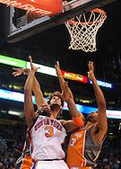 Mar. 26 2010; Phoenix, AZ, USA; New York Knicks guard Tracy McGrady (3) puts up a shot against Phoenix Suns forward Grant Hill (33) and Phoenix Suns' Robin Lopez (15) in the first half at the US Airways Center.  Mandatory Credit: Jennifer Stewart-US PRESSWIRE.