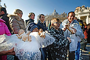 Vatican City dec 20th 2015, the pope blesses Baby Jesus figurines in St Peter's Square, during the Angelus prayer. In the picture