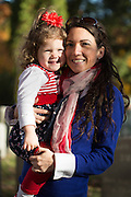 """Melissa Sciortino and Isabella Sciortino, 2, after visiting the gravesite of Susan B. Anthony, the social reformer who played a key part in the movement for women's suffrage, at Mount Hope Cemetery in Rochester on Tuesday, November 8, 2016.<br /> <br /> """"I wanted to take my daughter, since it's the first woman on the ballot. I felt it was historical and signifiant, since it'll be the first election she understands and there's a woman on it.""""<br /> <br /> """"I don't think Hillary, when she was playing Barbies when she was young, thought she could ever be President. And when my daughter plays Barbies she knows that she could be President one day. I felt I had to bring here so she could be a part of history."""""""