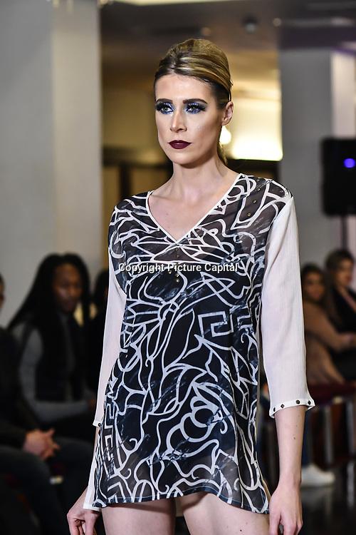 Samina Mughal showcases a set (City Style) at SMGlobal Catwalk - London Fashion Week F/W19 at Clayton Crown Hotel,  Cricklewood Broadway, on 1st March 2019, London, UK.