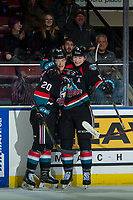 KELOWNA, CANADA - OCTOBER 10:  Kaedan Korczak #6 congratulates Conner Bruggen-Cate #20 of the Kelowna Rockets on a second period goal against the Seattle Thunderbirds on October 10, 2018 at Prospera Place in Kelowna, British Columbia, Canada.  (Photo by Marissa Baecker/Shoot the Breeze)  *** Local Caption ***