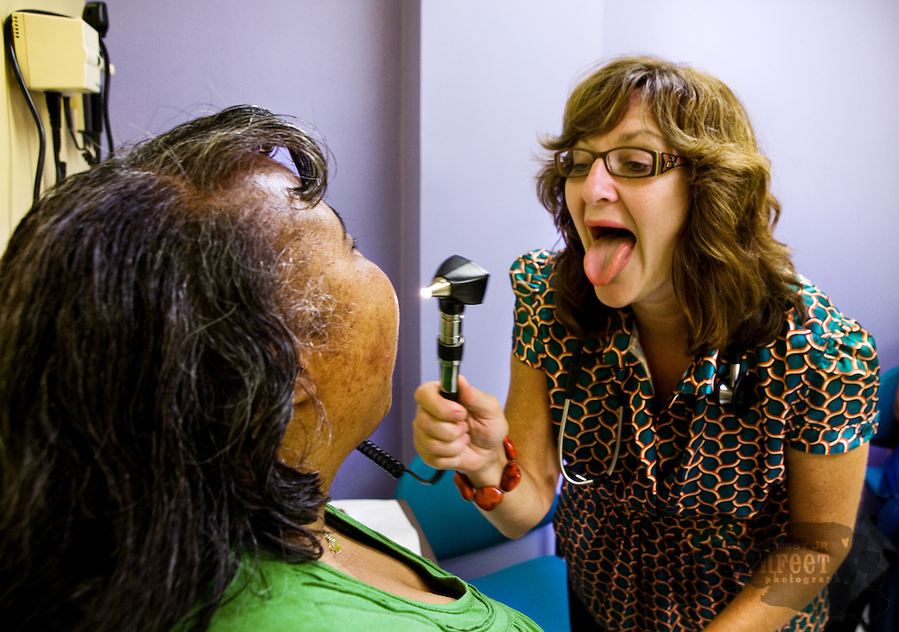 Photo by Gary Cosby Jr.  The Adult Down Syndrome Clinic at the University of Alabama in Birmingham is one of few facilities in America focusing on Down Syndrome.   Dr. Vickie Moore encourages Ingrid Kidd to open wide so she can see her throat during her exam.