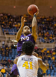 Feb 13, 2016; Morgantown, WV, USA; TCU Horned Frogs guard Malique Trent (3) shoots over West Virginia Mountaineers forward Devin Williams (41) during the first half at the WVU Coliseum. Mandatory Credit: Ben Queen-USA TODAY Sports