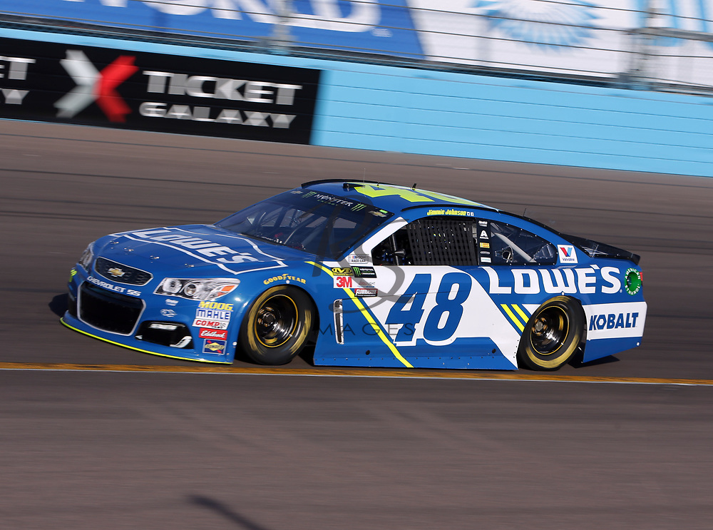 Jimmie Johnson qualifies for Sunday's NASCAR Cup Series auto race on Friday, March 17, 2017, in Avondale, Ariz.  (AP Photo/Rick Scuteri)