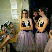 Ballet dancers are reminded to stay quiet as they wait backstage for their scene in the Nutcracker ballet in Des Moines, Iowa.